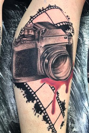 Realistic camera black n grey with a touch of colour!