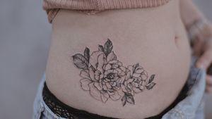 Side fineline botanical tattoo