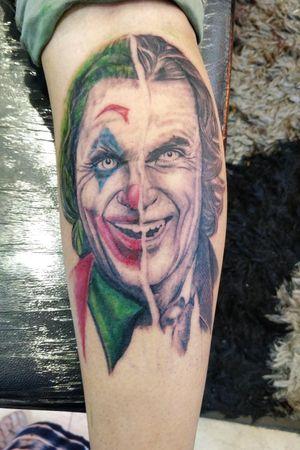 Realistic tattoo of joker on one of the joker fan .