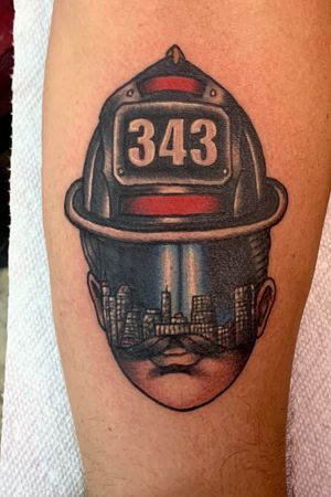 Traditional Firefighter 9/11 tribute tattoo with a like twist