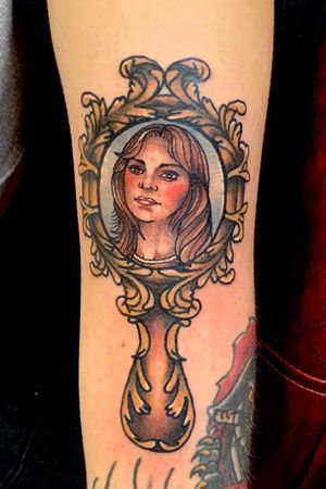 Traditional style portrait of my clients mom inside a vintage hand mirror