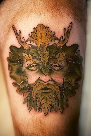 Green man face on thigh