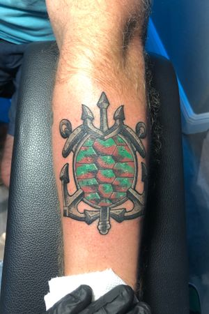 A cool spin on a shell back tattoo