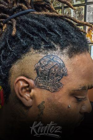 Logo tattoo by kintoz corner store on wheels atlanta