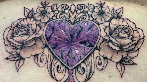 Ornamental crystal gem jewel roses lower back tattoo
