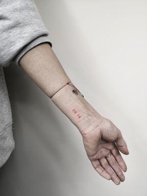 Red ink 🔥 Bookings only via Instagram. 🇱🇹 Lithuania, Kaunas 📸 Instagram: @nikita.tattoo 📨 info.artistnikita@gmail.com 🧭 #tattoo #tattoos #tattoodesign #tattooartist #linework #lineworker #lineworktattoo #thinlinetattoo #fineline #finelinetattoo #smalltattoo #minitattoo #minimalistic #minimalism #minimalistictattoo #linework #lineworker #red #redtattoo #redinktattoo #numbertattoo