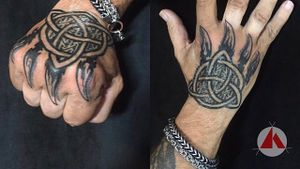 Pictish design within Triquetra and wolf claws... Hand tattoos for those who are super committed.