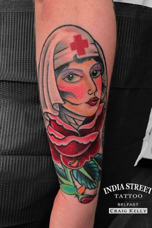 Traditional old school rose of no mans land girlhead tattoo by Craig Kelly