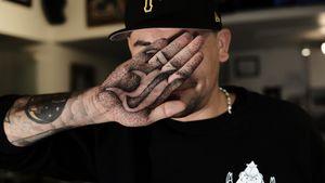 Dot work palm tattoo