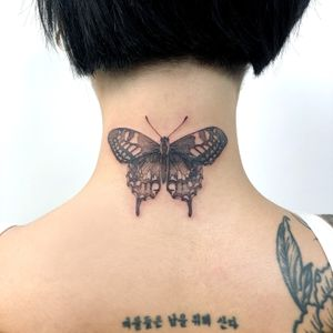 lettering cover up tattoo by June aka a.re tattoo #june #aretattoo #butterfly #coveruptattoo #wings #backofneck