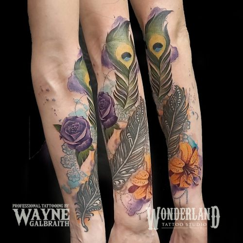 Got to add this sweet floral background to an existing feather tattoo, two different styles but I think it blends together perfectly! #wonderlandtattoo #wonderlandkitchener #colortattoo #mdwipeoutz #watercolortattooartist #watercolor #watercolortattoo #floraltattoo #ontariotattoos #canadiantattooartist  www.wonderlandstudioskw.com