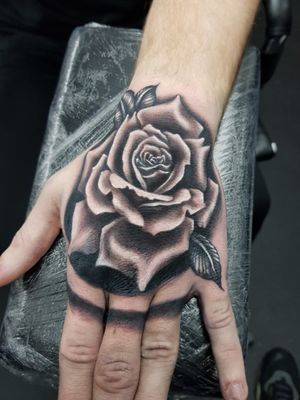 Rose hand tattoo from the other day, real fun piece