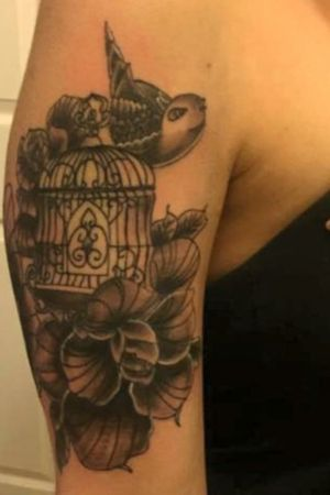 Birdcage and flowers