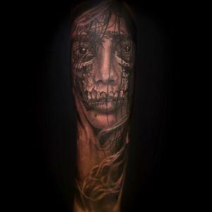 Black and Grey , lower arm, half woman half skull.