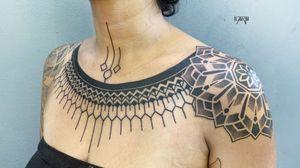 Tribalinspired chestpiece and shoulder Mandala #tribaltattoo #blackworktattoo #linework #dotworktattoo