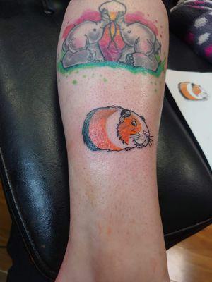 Rather unusual but still cool cheeky guinea pig tattoo #guineapig #animals #animaltattoo #colour #orange #cartoon #furbaby #Intenzetattooink #Chris51 #brightandbold #cheeky #WeirdTattoos