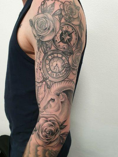 Black and grey sleeve #blackandgreytattoo #blackandgrey #roses #clock #compass #goattattoo #goat