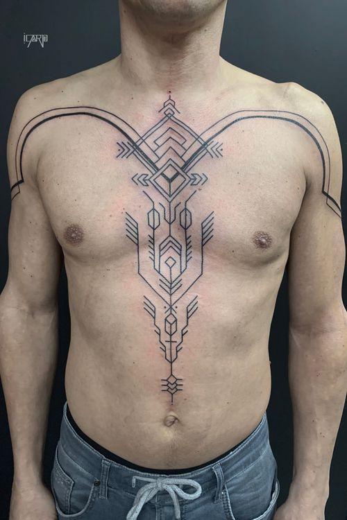 Spontanous tribal inspired chest tattoo