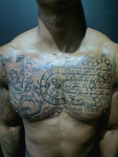 Full chestpiece done over 2 sessions, part healed. #chestpiece #clock #script #chest #chesttattoo #masks #cogs #chain