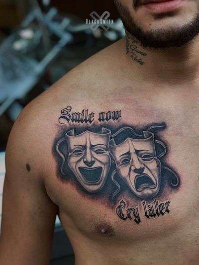 Smile now cry later tattoo by Kovalero #Kovalero #smilenowcrylater #blackandgrey #masks #dramamasks #chicano #illustrative #oldenglish #lettering #chest