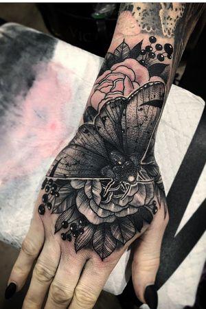 Hand tattoo by Nate Silverii aka hungryhearttattoos #NateSilverii #hungryhearttattos #handtattoo #moth #rose #flower #illustrative