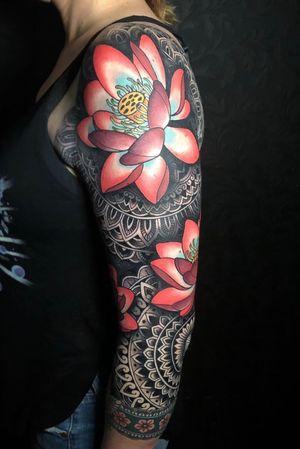Geometric sleeve with lotus flowers