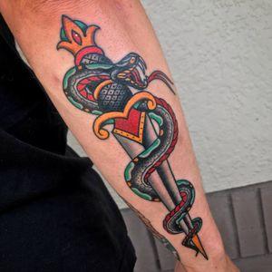 #snake #snaketattoo #dagger #daggertattoo #snakeanddagger #traditional #traditionaltattoo #traditionaltattoos #TraditionalArtist #bold #BoldTattoos #boldwillhold #arm #armtattoo #forearm #forearmtattoo #color #colorful #colortattoo