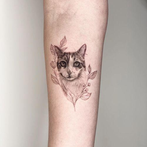Small realistic cat portrait