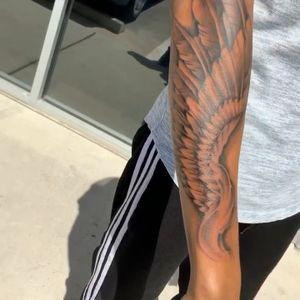 Wing tattoo I got do at Deviant Tattoo Studio ! Black and grey
