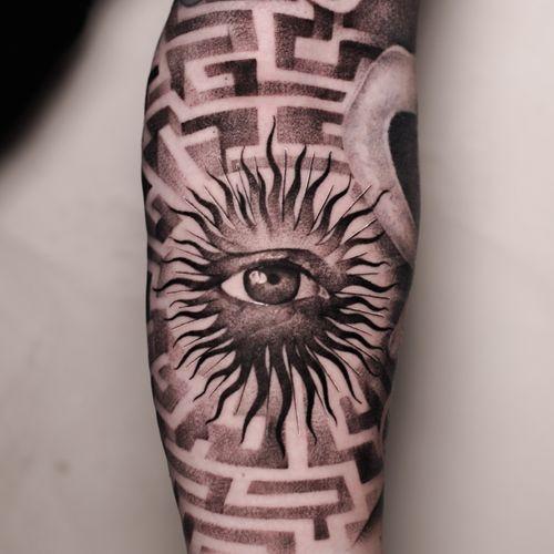 Eye tattoo by Anna Chernova #AnnaChernova #eye #sun #maze #blackandgrey #realism