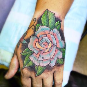Neo traditional rose hand tattoo