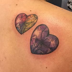 Rainbow and purple sparkly jewels memorial tattoo.