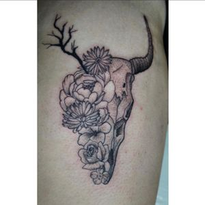 Bull skull head combined with flowers tattoo