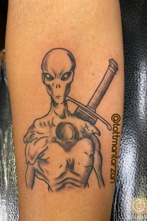 Alien tattoo with Trunks sword on his back