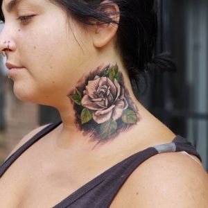 Rose tattoo with abstract background