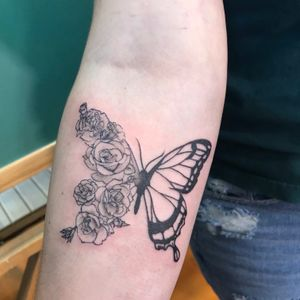 Custom floral butterfly with roses and carnations. Her first tattoo.