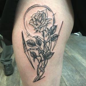 Custom skeleton hand and rose tattoo