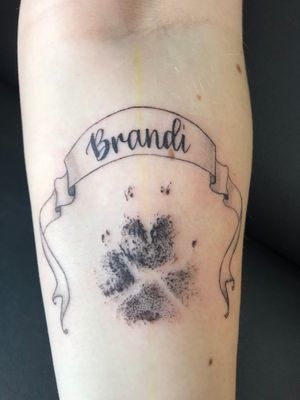 Memorial dog print tattoo done from an ink paw print the client brought in.