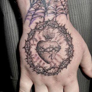 Hand tattoo by Deven Brodersen #DevenBrodersen #handtattoo #sacredheart #thorns #heart #fire