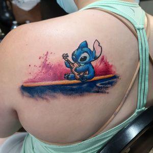 Surfing stitch!  #tattoo #cooltattoos #watercolortattoo #texasartist #inkedchick #ladieswithtattoos #stitch #liloandstitch #surfing #surf #ukulele #cartoon #disney
