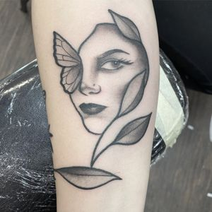 Face /butterfly done at Philadelphia tattoo collective in black and grey