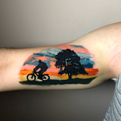 Cycling silhouette tattoo, the background based on my painting.