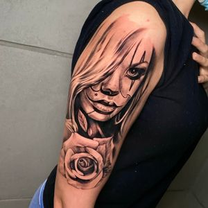 Realistic girl face and rose.