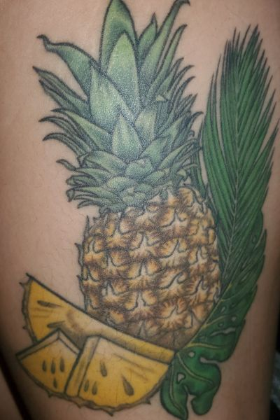 Colored tropical thigh tattoo- Pineapple and palm leaves #pineapple #fruit #tropical #monstera #pineappletattoo #foodtattoo #tropicaltattoo #thightattoo #palmleaf #leaves #plant #nature