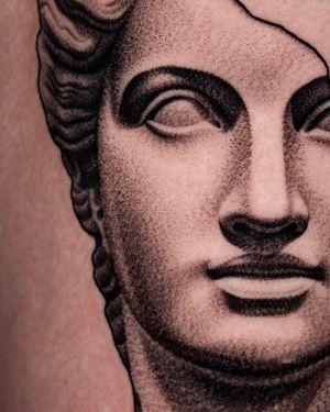 Broken greek statue close up