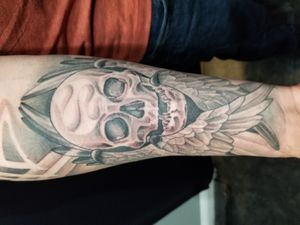 Skull and wings tattoo by Nathan Emery, San Francisco