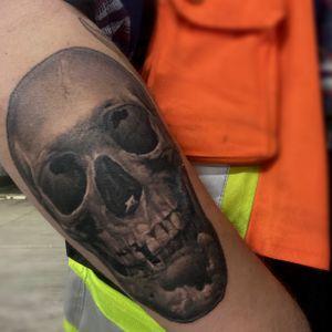 Healed skull tattoo