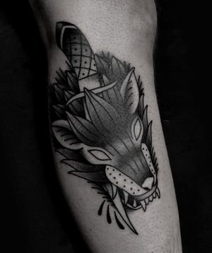 Stabbed wolf head traditional tattoo by satanischepferde #wolf #wolftattoo #dagger #stabbed #wolfhead #traditionaltattoo #blacktattoo #blacktraditional #legtattoo #erfurt #germany