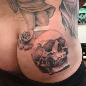 Work in progress skull and rose butt tattoo