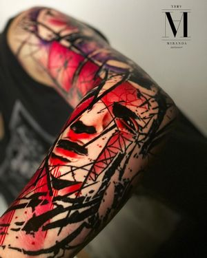 Full sleeve tattoo representing a woman's face in an abstract concept avantgarde style.